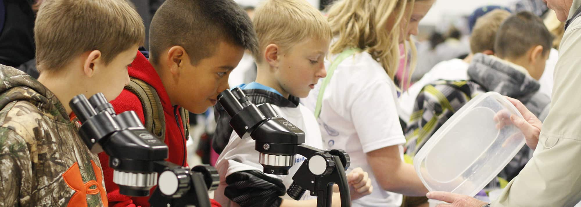 Kids with microscopes